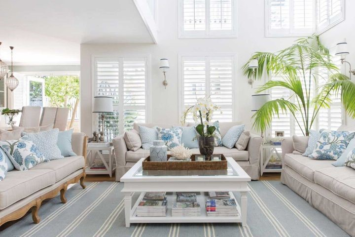 Large Open Space Living with white on White plantation shutters and amazing lux decor