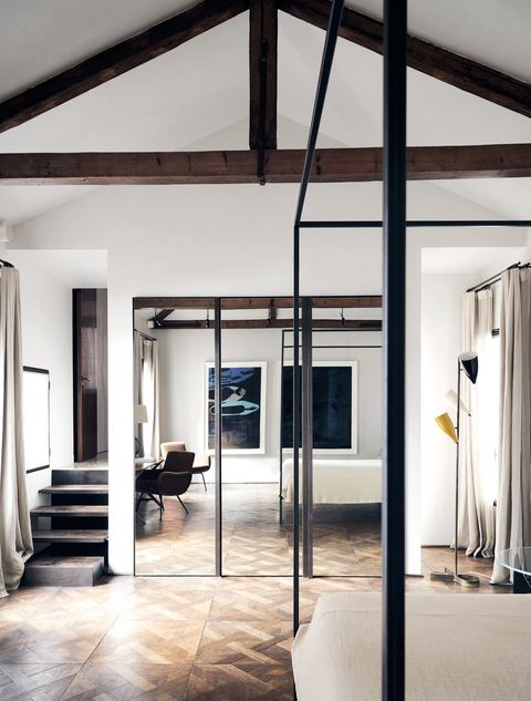 Little Italy Barn Style Loft bedroom design with exposed beams and parkentry floorboards