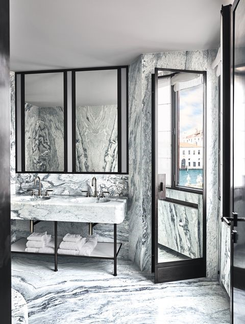 Marble Bathroom finish from top to bottom and Matte Black finishes. Beautiful marble vanity