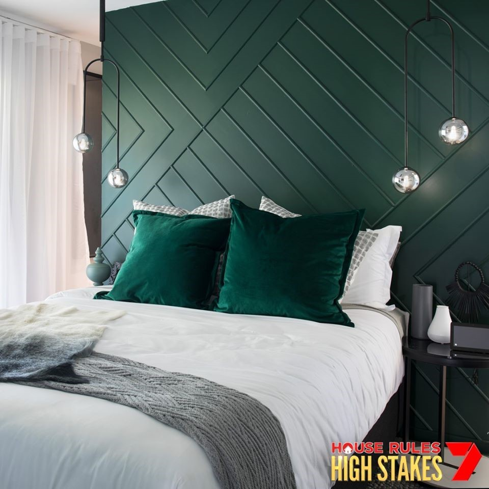 Sleek and modern minimalist approach. A semi-wall in jade green creates a two-in-one function (wardrobe and bedroom) in this renovated master bedroom