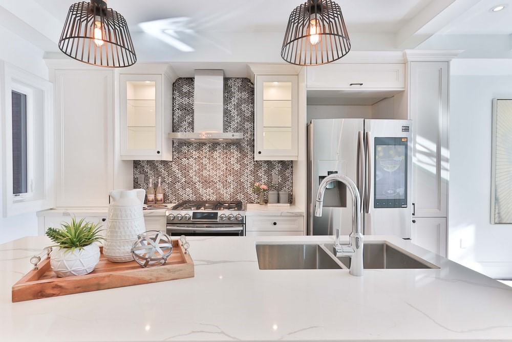 Beautifully renovated kitchen with mosaic splash back and pendant downlights to Increase Your Property's Value