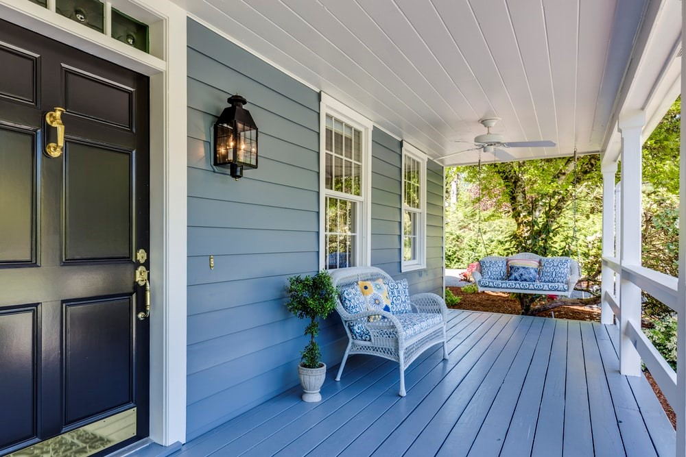 Amazing Renovation Ideas that used blue colours for the porch and the swing