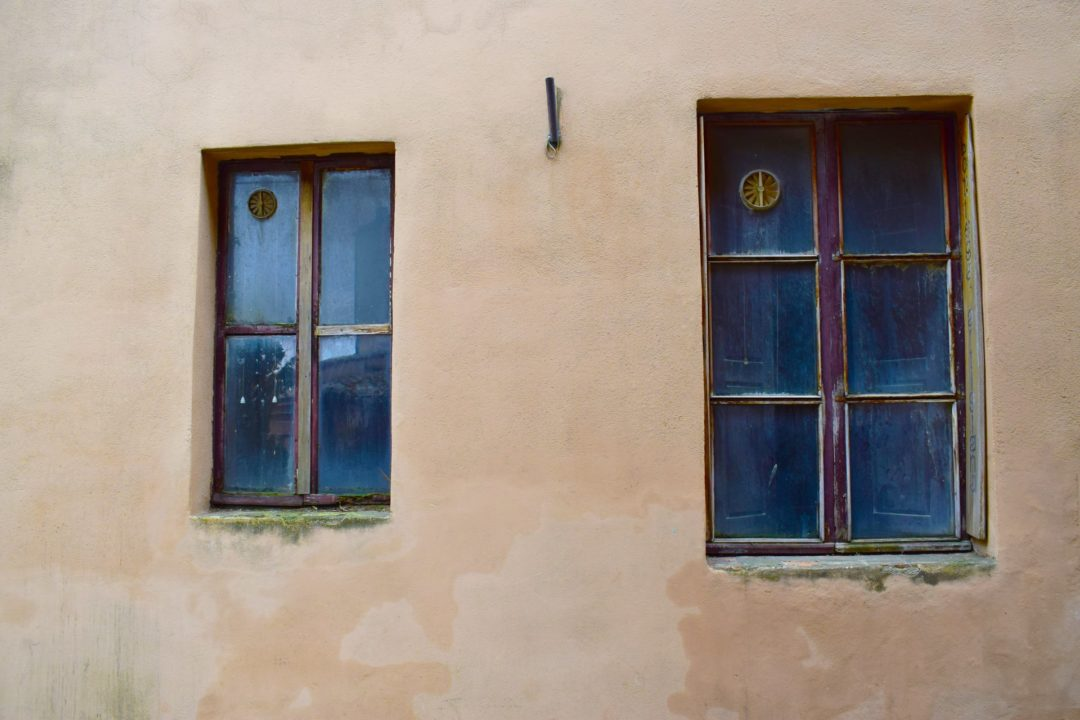 Old Rotted windows with cement walls