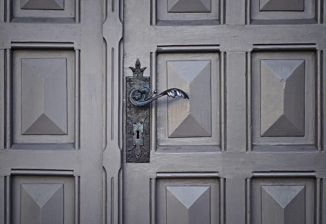 Grey front door with european door handles