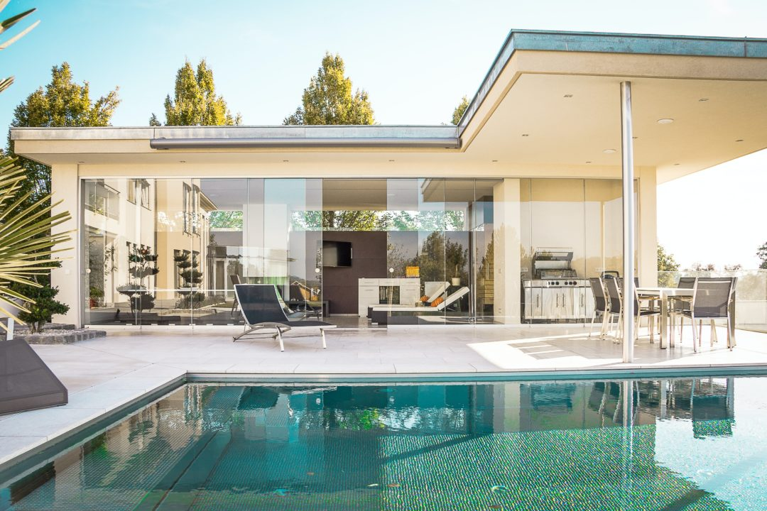 Beautiful house with floor to ceiling windows with a pool won at auction