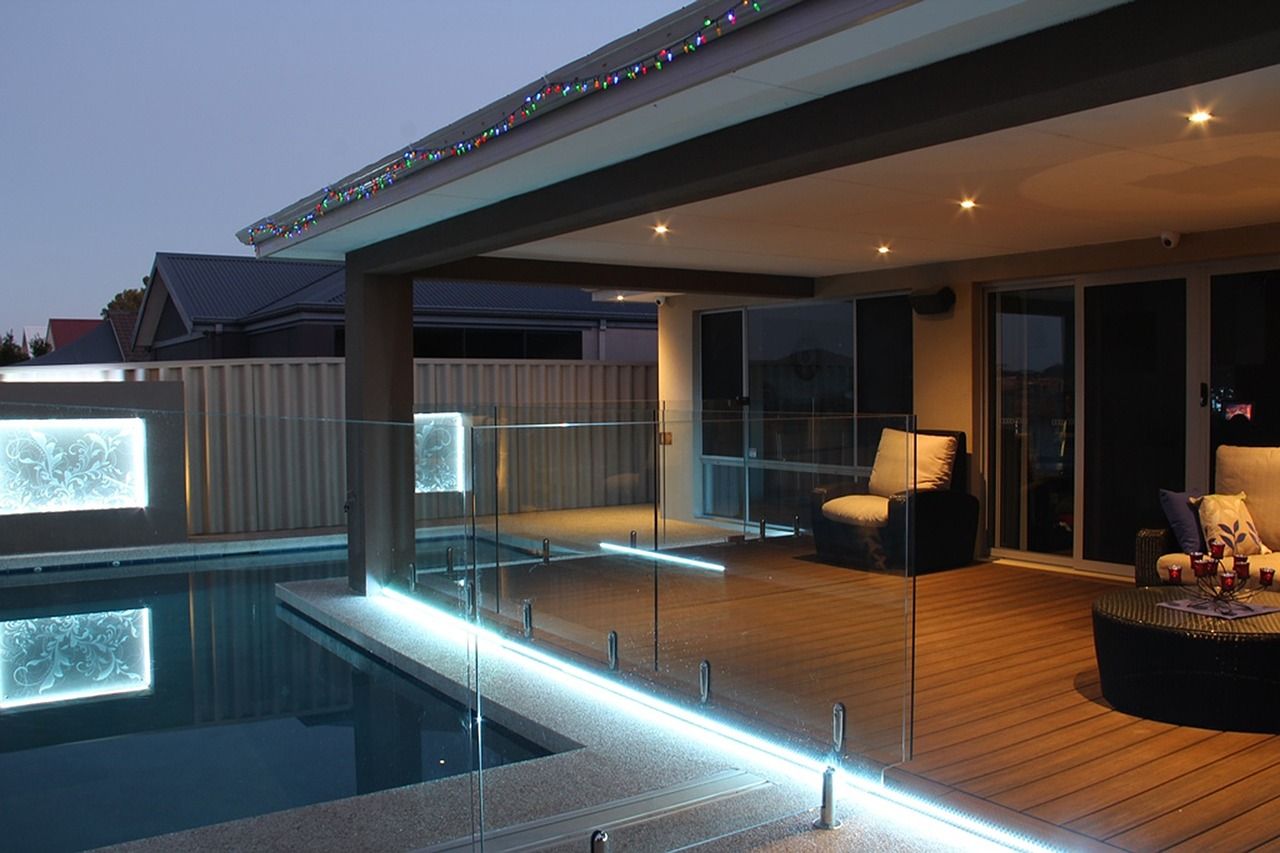 Out door seating area deck patio with light up pool lights used to Increase the Value to Your Property